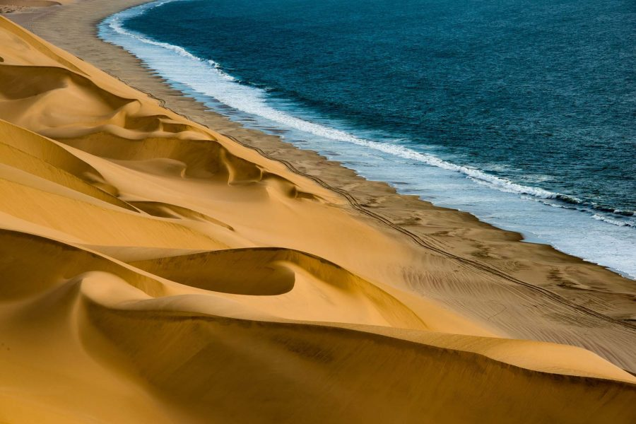 dunes sea coast namibia africa water sand
